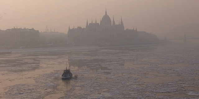 Foggy photo taken during wintertime of the icy river Danube and the Hungarian Parliament building