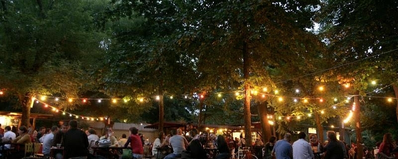 Evening picture of Kertem, an atmospheric garden bar in the City park on the Pest side of Budapest