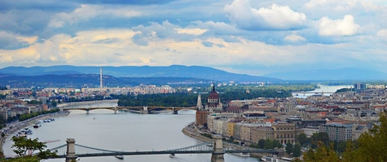 This is a beautiful view of Budapest and the river Danube from the top of the circa 150 meters tall Gellért hill in Buda