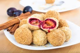 Szilvásgombóc is a dumpling rolled in breadcrumbs filled with plum and it is a beloved dessert of Hungarians