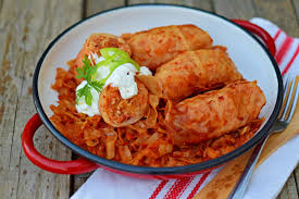 Rolls of Töltött káposzta or Stuffed cabbage in English, which is a cabbage roll filled with a mixture of minced meat, rice and spices