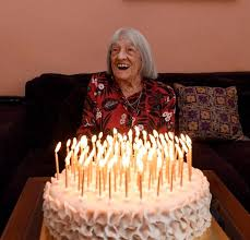 The hundred year old Ágnes Keleti, the world's oldest living Olympic champion with her birthday cake on the 9th of January