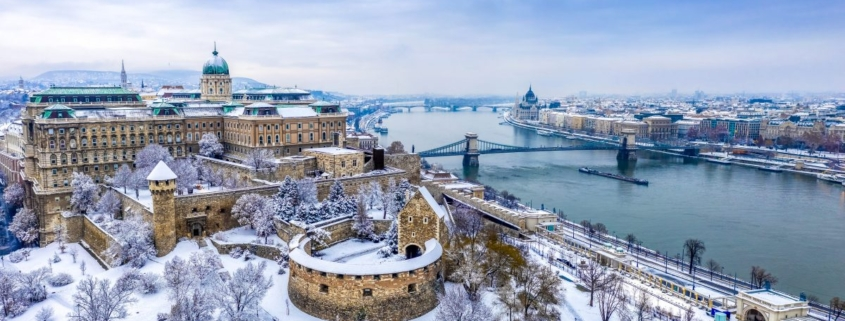 Aerial view of Buda with the Castle district and Pest with the Parliament and the river Danube in wintertime