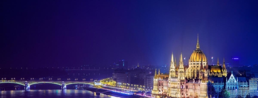 Beautiful image of the lit up Hungarian Parliament building and the river Danube